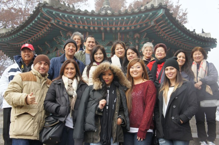 A group of our happy club members posing in front of a popular monument in Korea