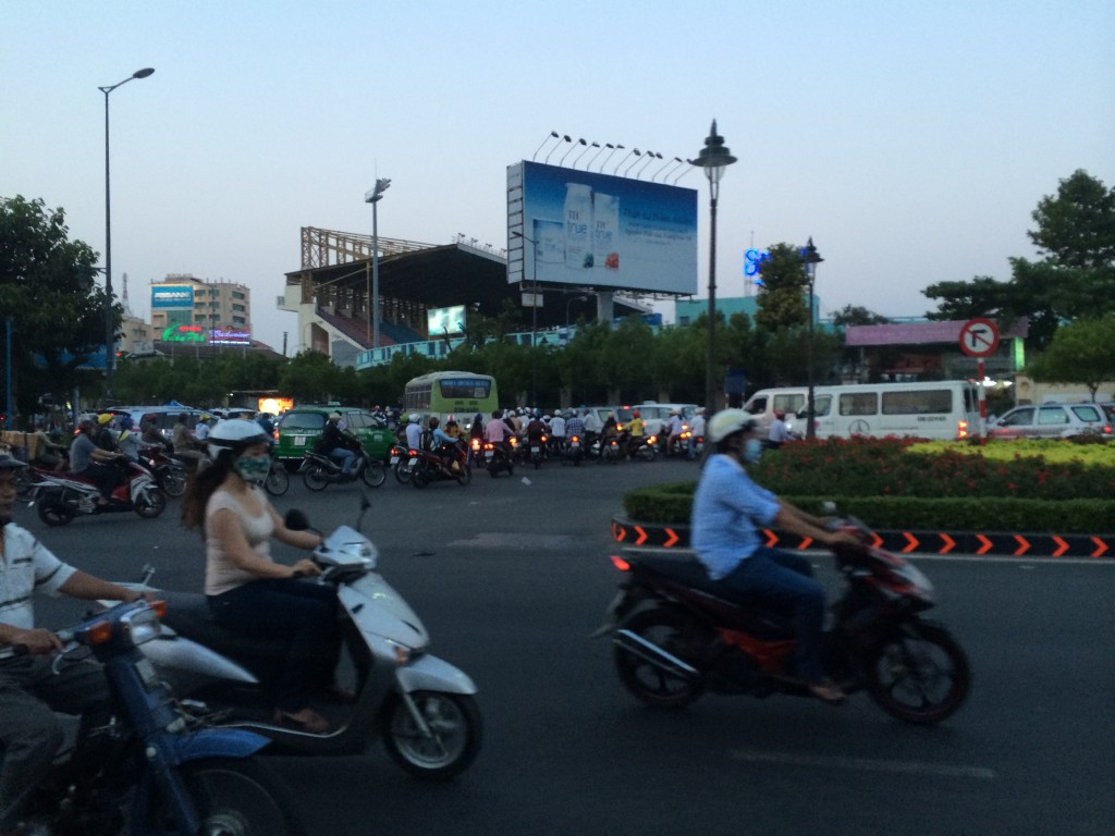 people riding mopeds in the city